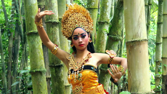 young balinese dancer performing legong dance in a bamboo forest - traditional ceremony stock videos & royalty-free footage