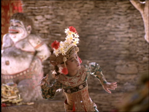 young balinese girl in costume performing native dance / indonesia - 1997 stock-videos und b-roll-filmmaterial