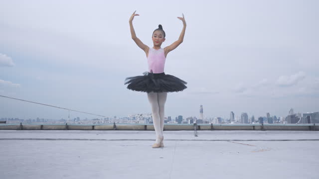 young ballerina and ballet dancing on top building,  graceful woman spinning in ballet - smooth stock videos & royalty-free footage