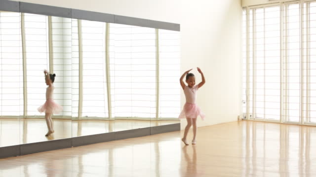 ws young ballerina dancing alone in a studio. - mirror stock videos & royalty-free footage