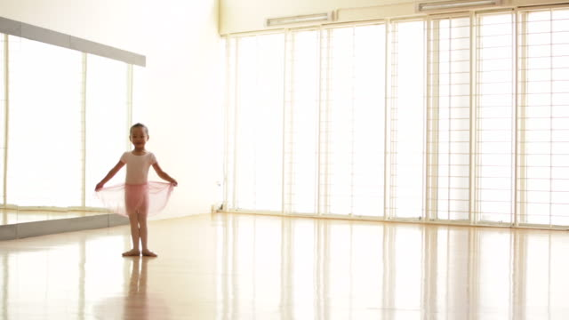 ws young ballerina dancing in ballet studio. - ballettröckchen stock-videos und b-roll-filmmaterial