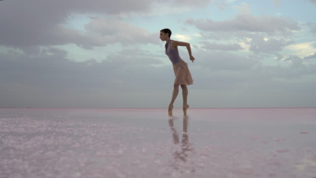 young ballerina dancing on the lake in the morning - ballet dancer stock videos & royalty-free footage