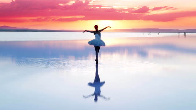 young ballerina dancing on water - art stock videos & royalty-free footage