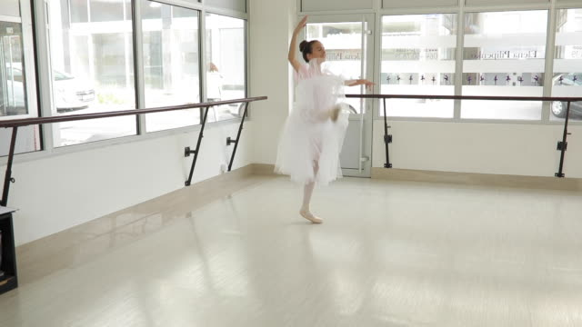 young ballerina in tutu doing ballet pirouette - pirouette stock videos and b-roll footage