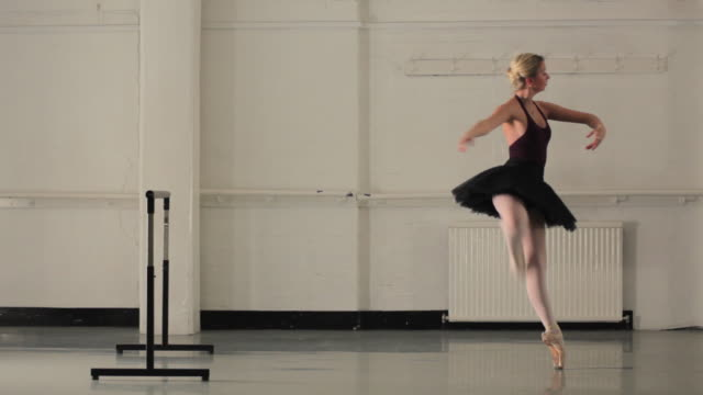 ws young ballerina rehearsing in dance studio / london, england - ballerina stock-videos und b-roll-filmmaterial