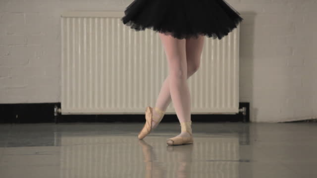 ms pan young ballerina rehearsing in dance studio, low section / london, england - ballet shoe stock videos and b-roll footage
