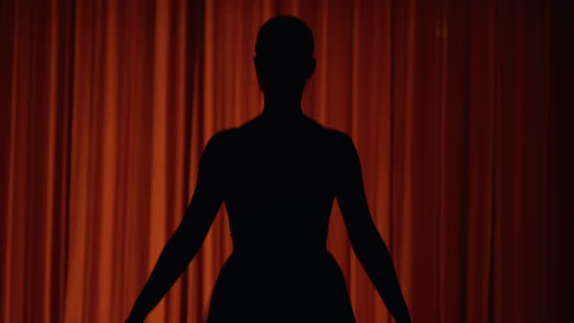 slo mo young ballerina walks into the stage after the curtains open - atmosphere filter stock videos & royalty-free footage
