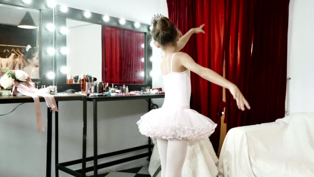 young ballerina wearing white tutus and dancing - 8 9 years stock videos & royalty-free footage