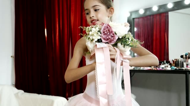 young ballerina with bouquet practicing in backstage - 8 9 years stock videos & royalty-free footage