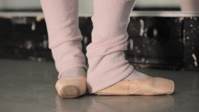 cu pan young ballerina's feet / london, england - en pointe stock videos and b-roll footage