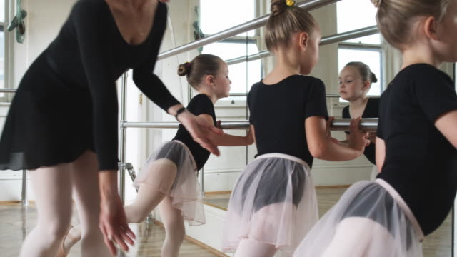 young ballerinas in a dance studio - ballettstange stock-videos und b-roll-filmmaterial