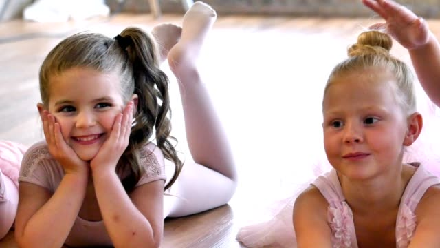 young ballerinas wait for class to begin - reclining stock videos and b-roll footage