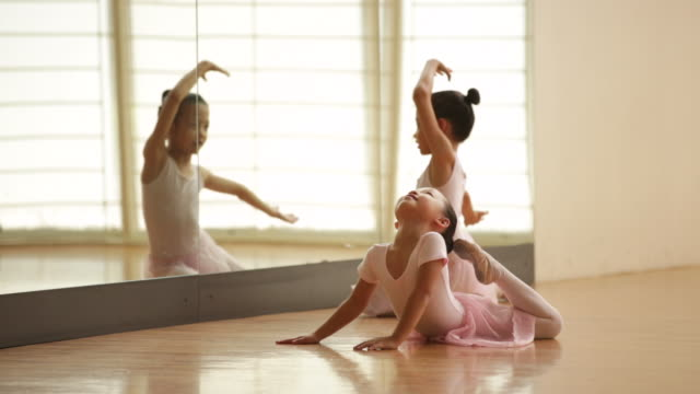 ws young ballerinas warming up before class. - mirror stock videos & royalty-free footage