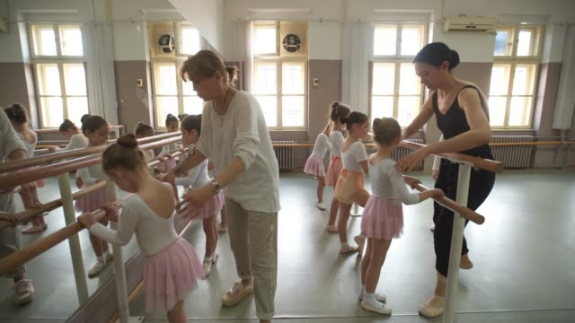 young ballerinas working on their postures - ballet shoe stock videos and b-roll footage