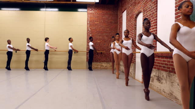 ms young ballet dancers practicing at barre in studio - gymnastikanzug stock-videos und b-roll-filmmaterial