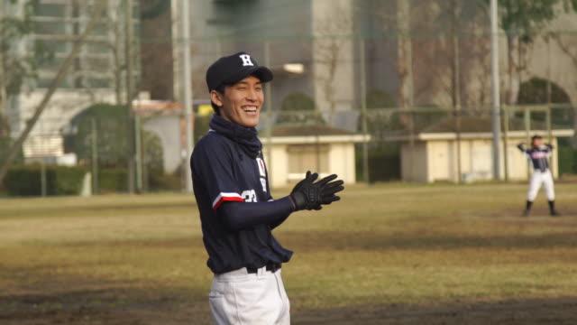 young baseball players laugh while playing baseball - japan - baseball sport stock videos & royalty-free footage