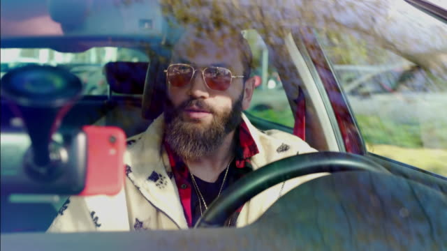 young bearded man driving a car - windshield stock videos & royalty-free footage
