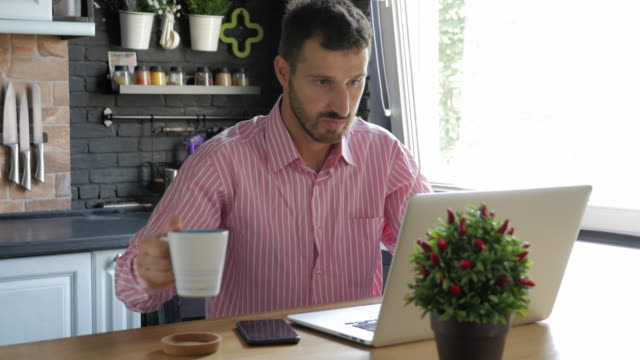 young bearded men working on laptop and drinking tea at home - hair stubble stock videos & royalty-free footage