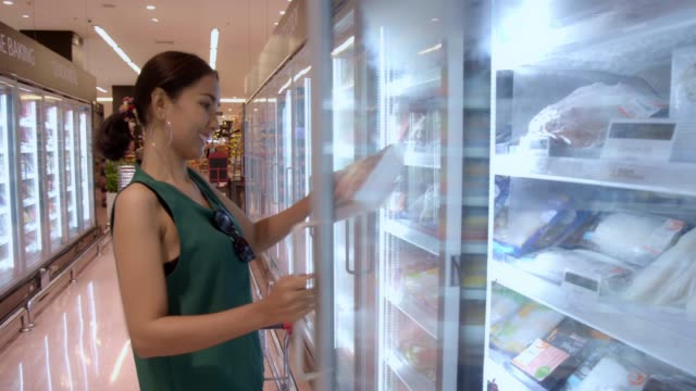 young beautiful asian woman buying fresh frozen seafood at the grocery store supermarket. - body concern stock videos & royalty-free footage