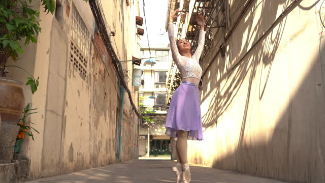young beautiful ballerina dancing along the street - classical stock videos & royalty-free footage