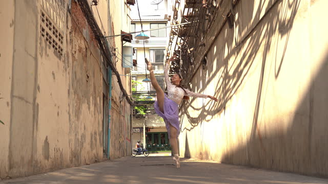 young beautiful ballerina dancing along the street - ballet dancer stock videos & royalty-free footage
