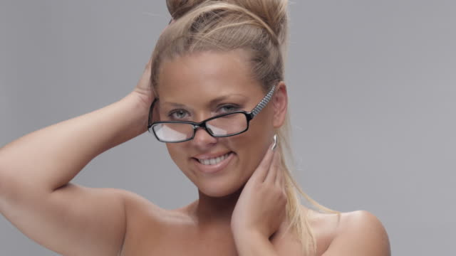 young beautiful blond woman with glasses looking at camera and flirting. - green eyes stock videos and b-roll footage