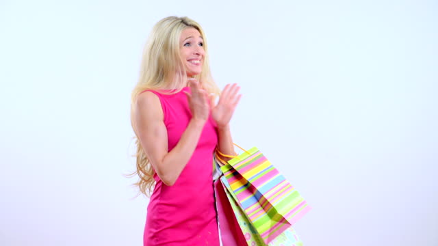 Young beautiful blond woman with shopping bag