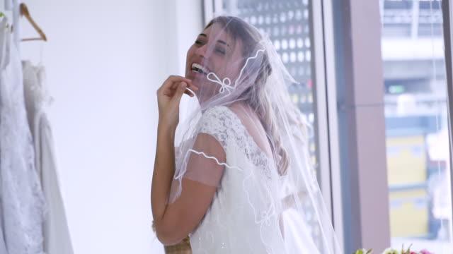 Young beautiful bride wearing fluffy dress posing in studio room