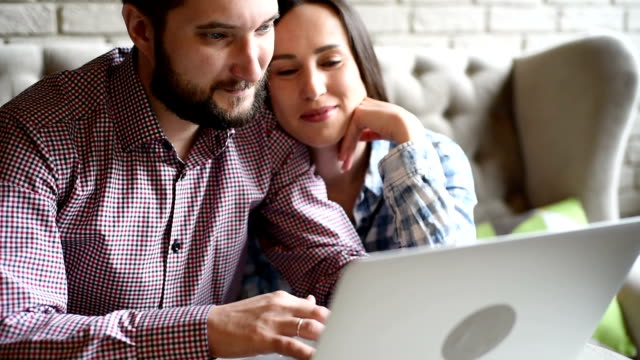 young beautiful couple with laptop
