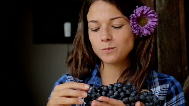 young beautiful female tasting grapes - grape stock videos & royalty-free footage