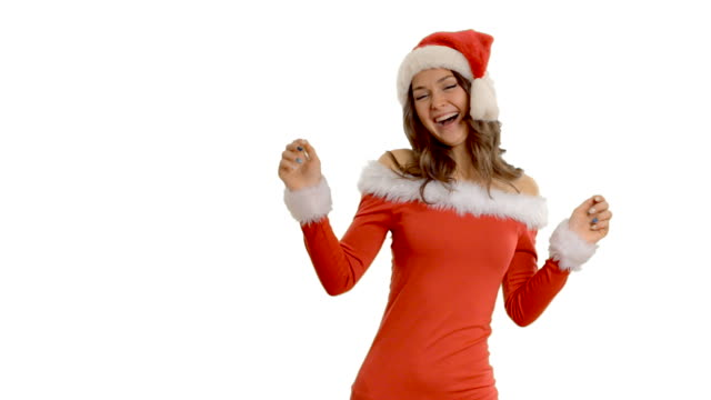young beautiful girl dancing in a cap of santa claus - santa hat stock videos and b-roll footage