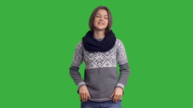 Young beautiful girl in winter sweater with alpha channel