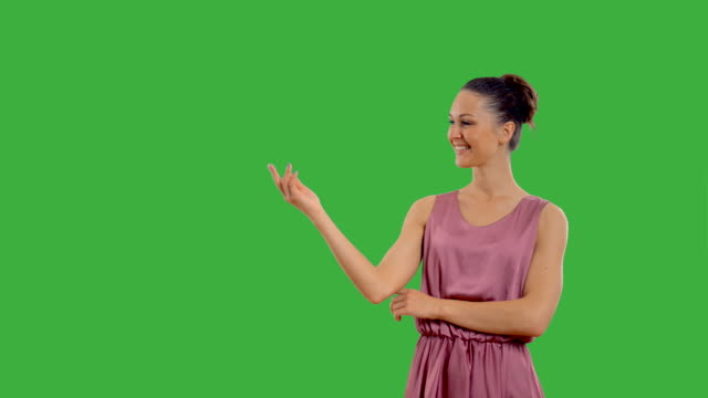 young beautiful girl on the green screen with alpha channel. - beautiful woman stock videos & royalty-free footage