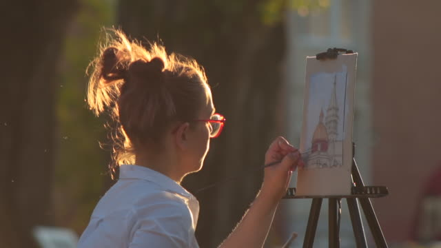 young beautiful girl painting outdoors - oil paint stock videos & royalty-free footage