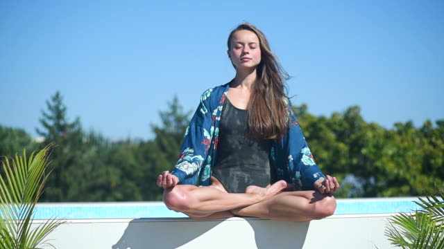 young beautiful girl sitting in the lotus position - girls wearing see through clothes stock videos and b-roll footage