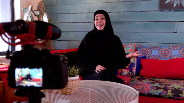 young beautiful muslim lady in hijab blogger talking on camera - blogging stock videos & royalty-free footage