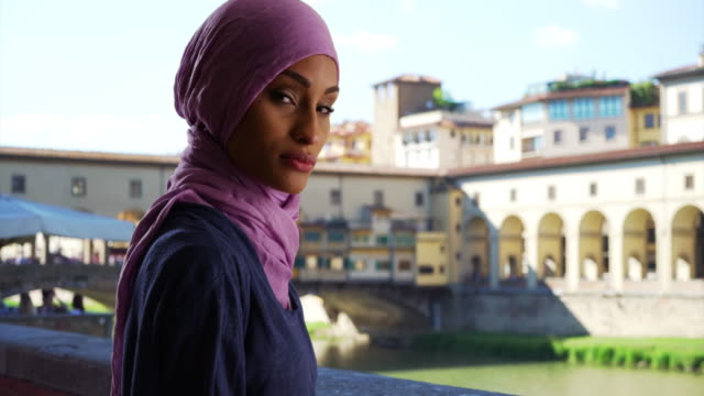 young beautiful muslim woman in florence, italy posing for a portrait - modest clothing stock videos & royalty-free footage