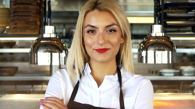 young beautiful waitress in apron standing with arms crossed in cafe or restaurant - catering occupation stock videos & royalty-free footage