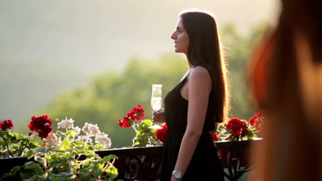 Young beautiful woman drinking wine