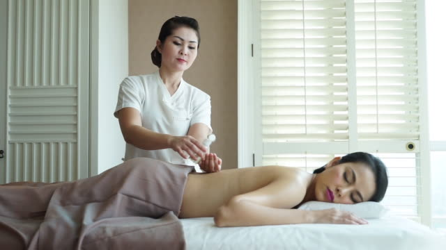 young beautiful woman enjoying oil massage - massage oil videos stock videos and b-roll footage