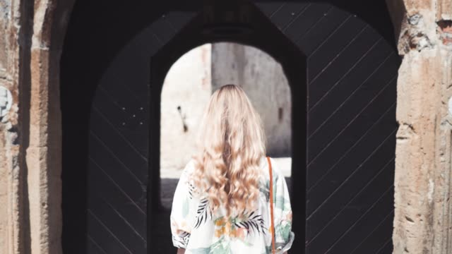 young beautiful woman exploring the castle - entrare video stock e b–roll