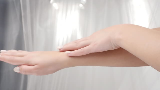 BEAUTY. Young Beautiful Woman Hand Care