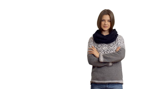 young beautiful woman in a winter sweater on a white background