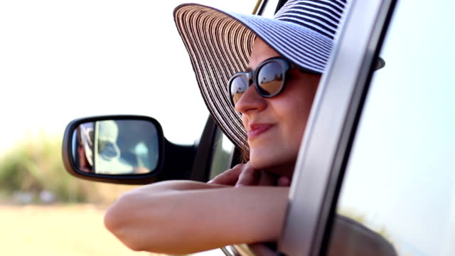 young beautiful woman in the car - road trip stock videos and b-roll footage