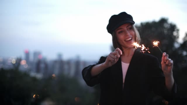 young beautiful woman making a wish with a sparkler - composition stock videos & royalty-free footage