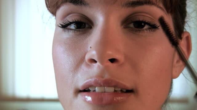 HD: Young beautiful woman mascara