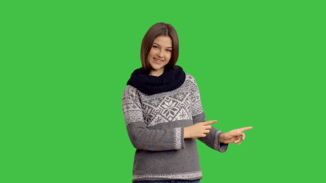 young beautiful woman showing blank area and the thumb on a green background - thumb stock videos & royalty-free footage