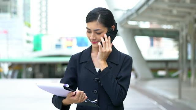 Young beautiful woman talking by mobile phone with serious emotion.