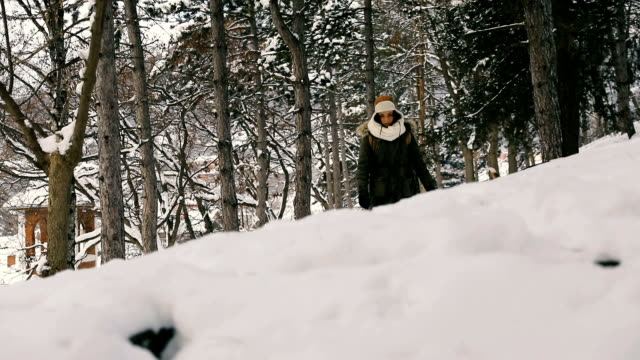 young beautiful woman walking in winter park smiling - mitten stock videos and b-roll footage