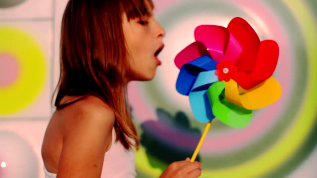 young beautyful girl blowing a pinwheel - asthmatic stock videos and b-roll footage